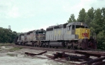 Louisville & Nashville SD40-2's 3560, 8026 & 1277 lead a Crystal River 85-car coal train past the south house track switch at the old depot site 